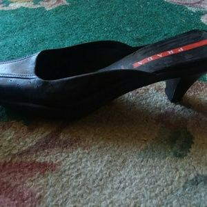 Authentic black leather Prada slip-on with  heeled